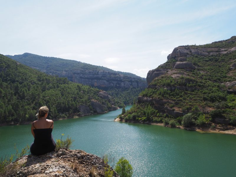 Girl looking out at river view in spain after quitting work to travel