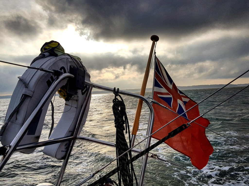 a boat sailing through british waters