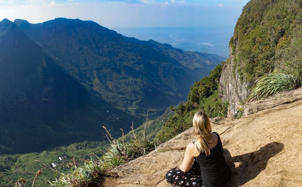 Trekking Horton Plains-world's end, Sri Lanka.  A girl looking out over the  mountain view.