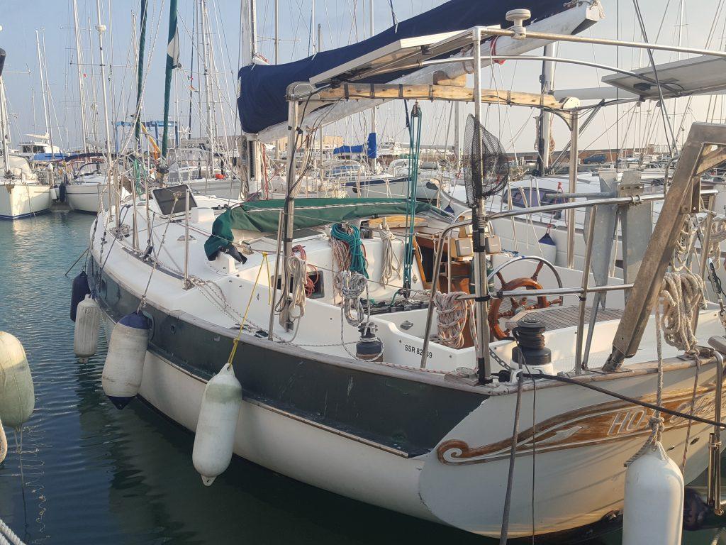 a sailboat called hot chocolate in marina di ragusa marina