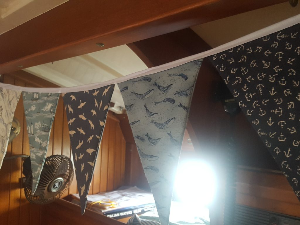 making your sailboat feel like home with some pretty fabric bunting