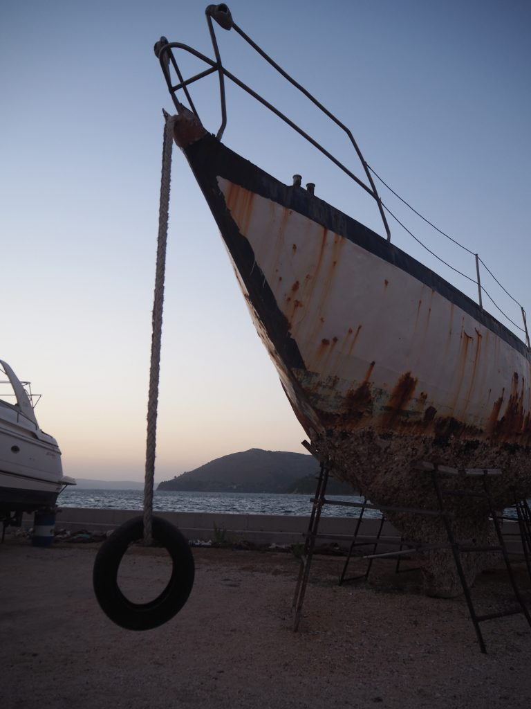 this rusty old boat was owned by someone who found out what it really costs to live on board a sailboat