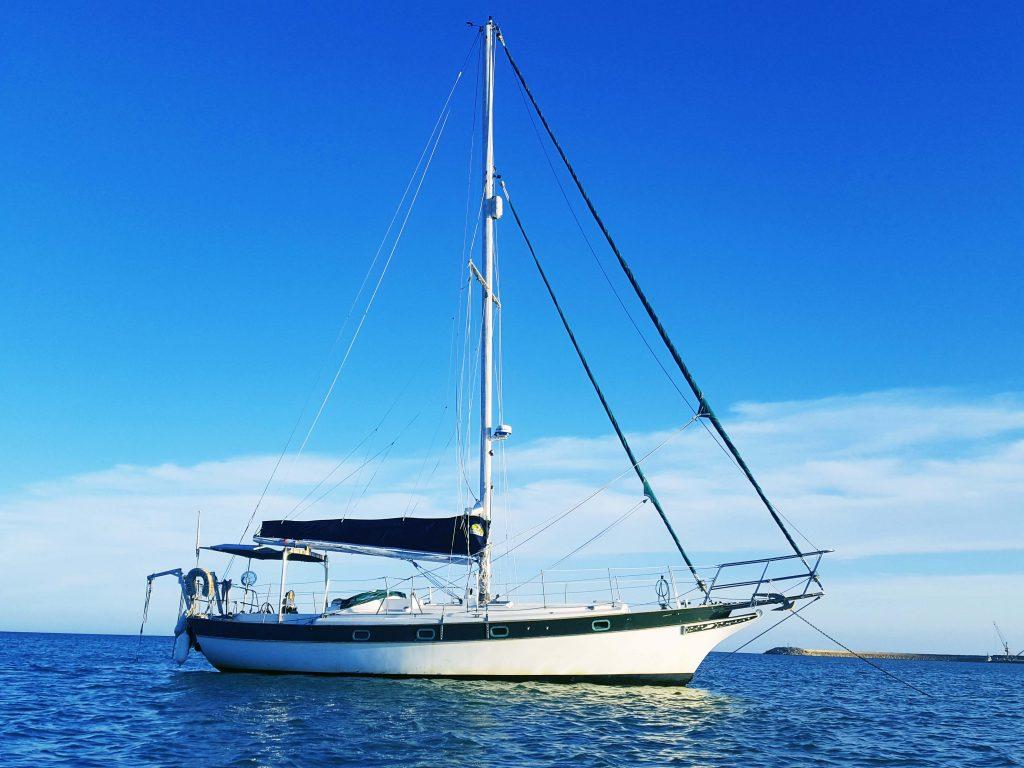 a sailboat at anchor in sicily