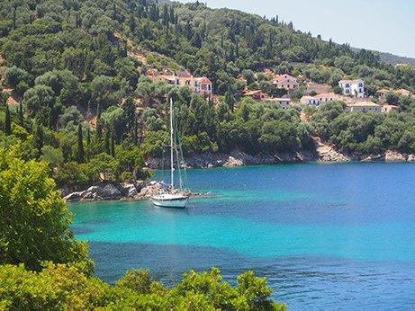 a sailboat in a stunning Greek bay
