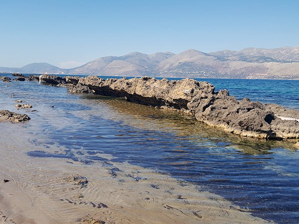 A beautiful beach in Lixouri town with rock pools. One of the many things to do.