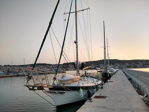 a sailboat moored in argostoli harbour in greece
