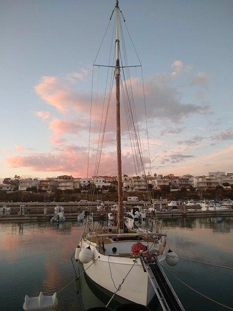 A steel hull sailboat AT SUNSET