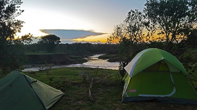 Camping at Ol Pejeta safari park.  Two tents and a sunrise.