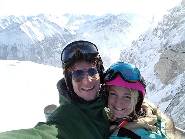 All smiles from a couple on their first time skiing experience in the mountains