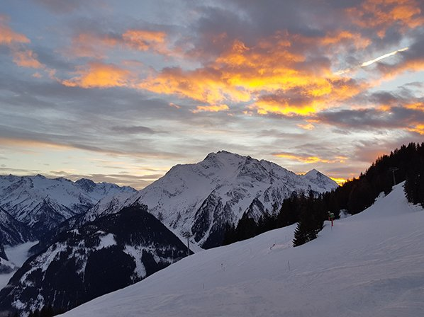 Sunset over the mountains of a ski resort