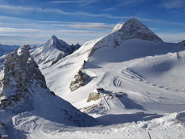 White mountain peaks and ski tracks in a ski resort