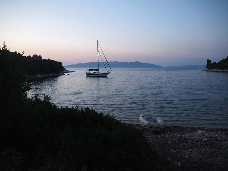 A sailboat anchored all along on Kastos island in Greece