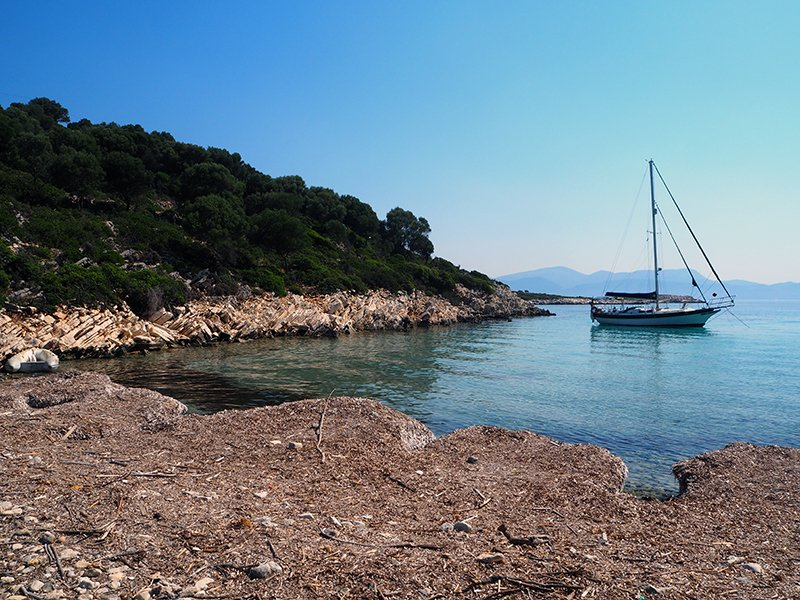 Wasp bay on Kastos island with a sailboat anchored out