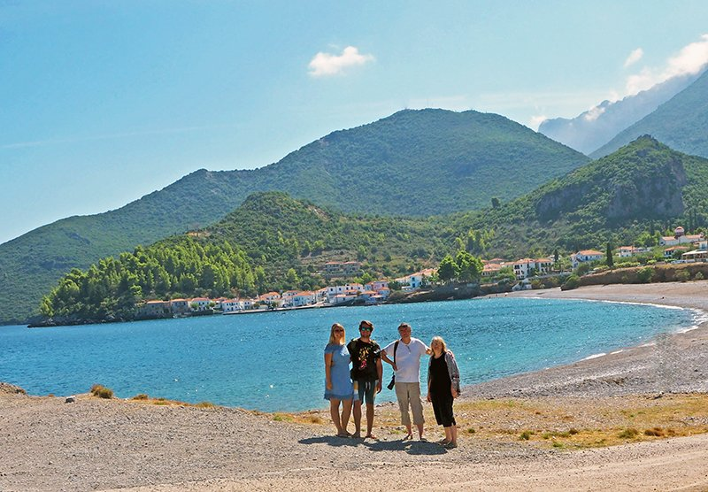 A FAMILY EXPLORING A TOWN IN GREECE