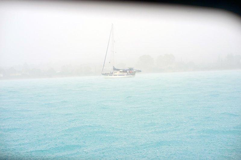 LOTS OF RAIN SPLASHING ON THE SEA IN A THUNDERSTORM