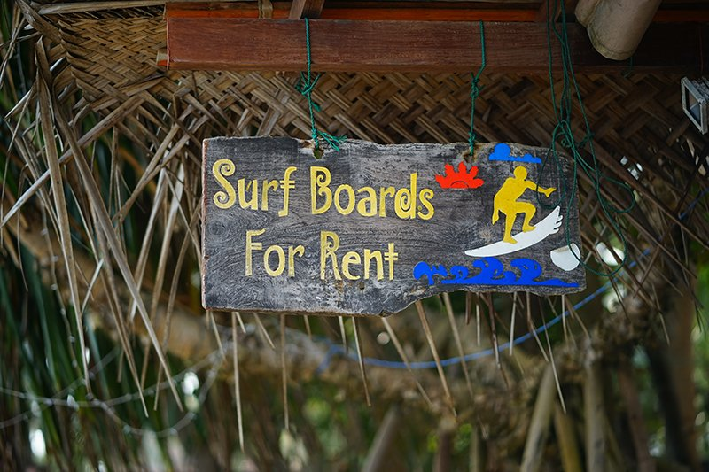 Surf board for rent sign in bright colours in sri lanka