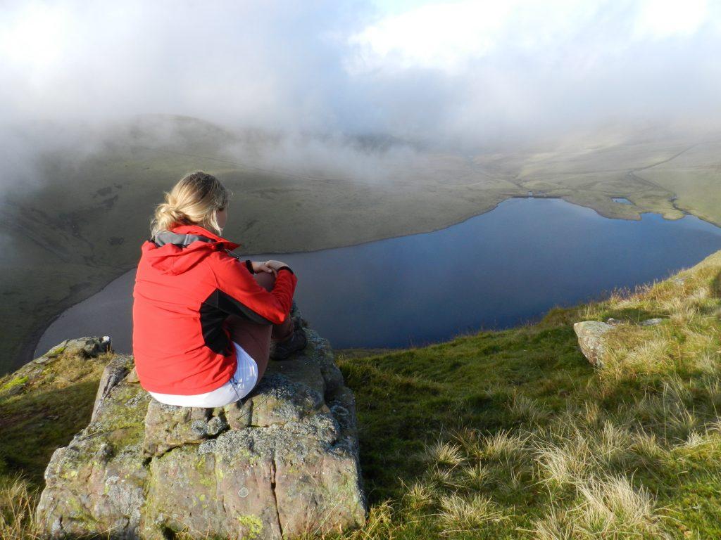 A GIRL CLIMBING A MOUNTAIN IN WALES