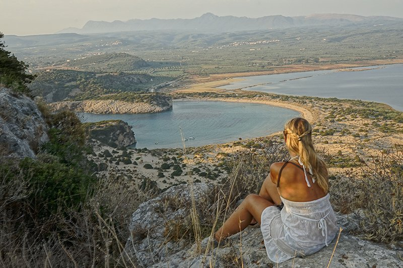 WATCHING THE SUNSET FROM CASTLE RUINS IN PILOS IN GREECE