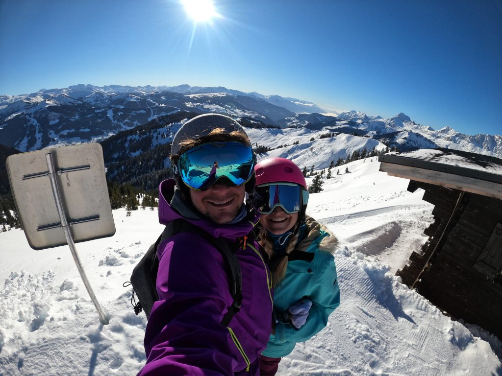 The best action camera for vloggers, a picture taken on a go pro hero 8 of two people on the top of a mountain