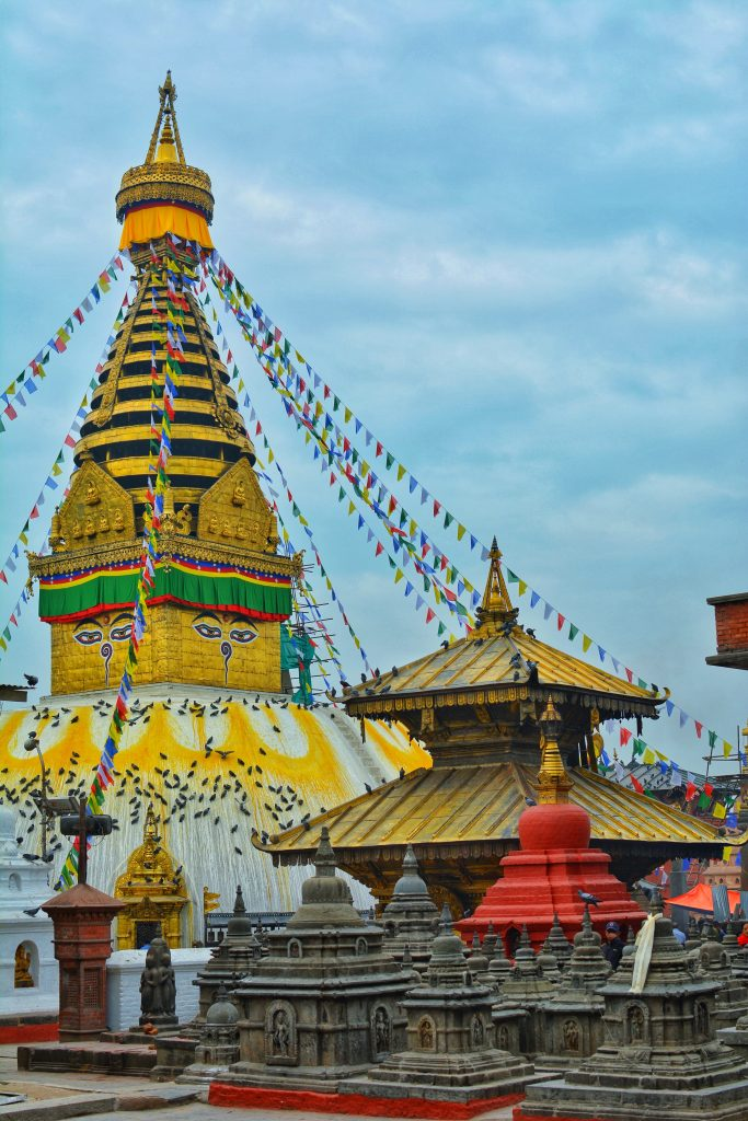 BOUDHA TEMPLE IN NEPAL WITH PRAYER FLAGS HUNG ALL OVER IT