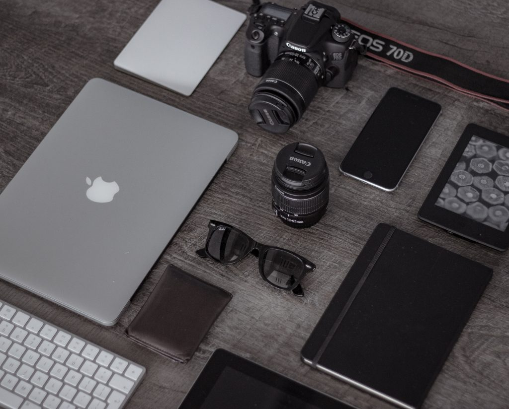 A CAMERA LAID OUT NEATLY IN AN OFFICE