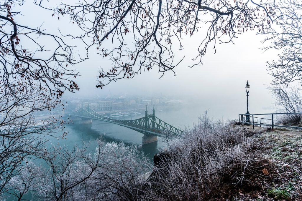 BUDAPEST FROM A ROMANTIC VIEWPOINT, LOOKING DOWN ONTO A BRIDGE BELOW.