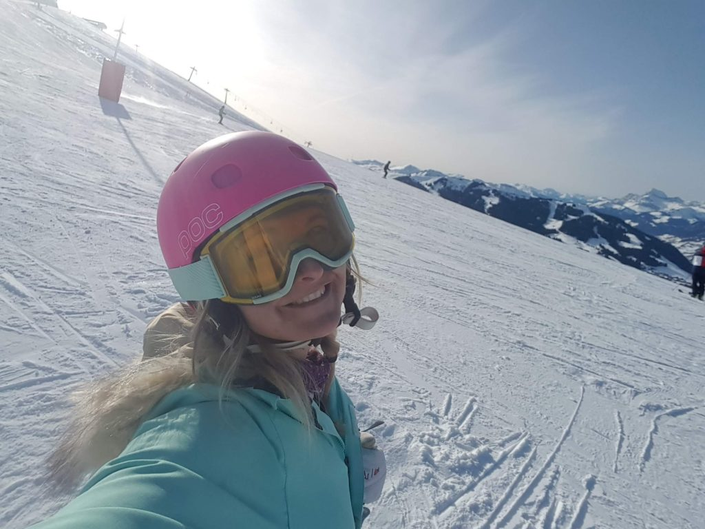 a girl going skiing on a black run