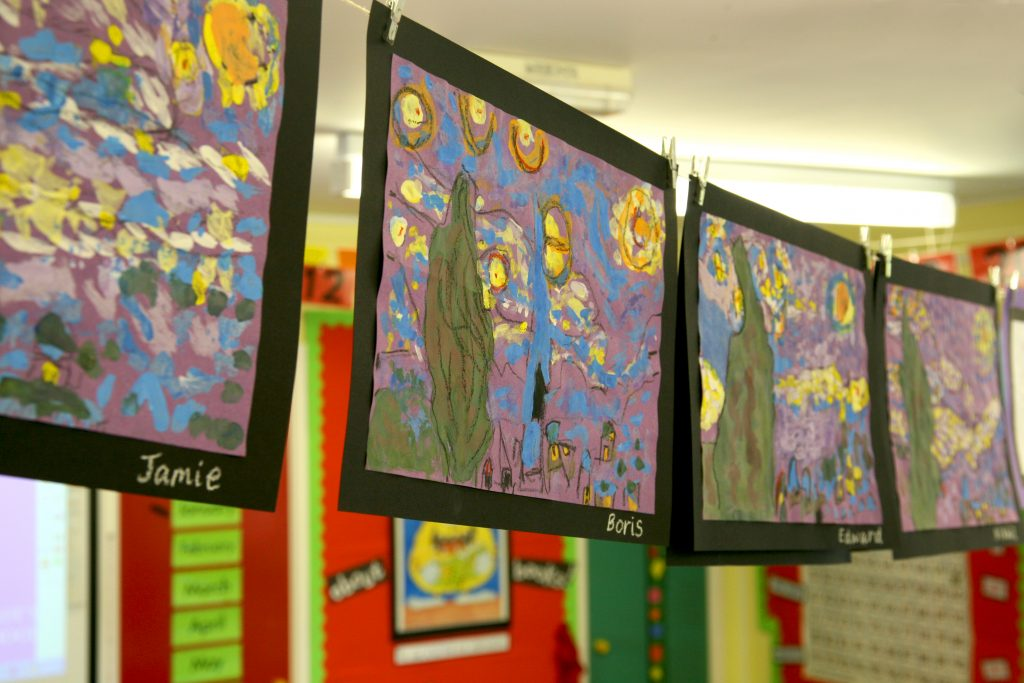 paintings in a classroom to show you can be creative when home schooling