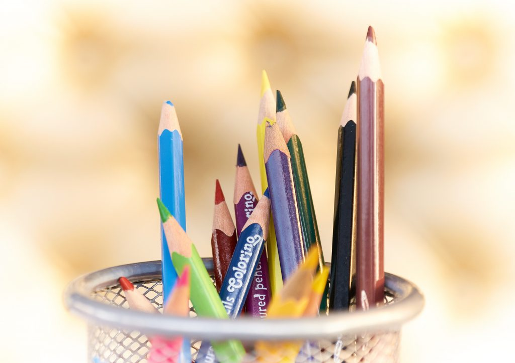 A set of colouring pencils in a pot at a homeschool for different year groups