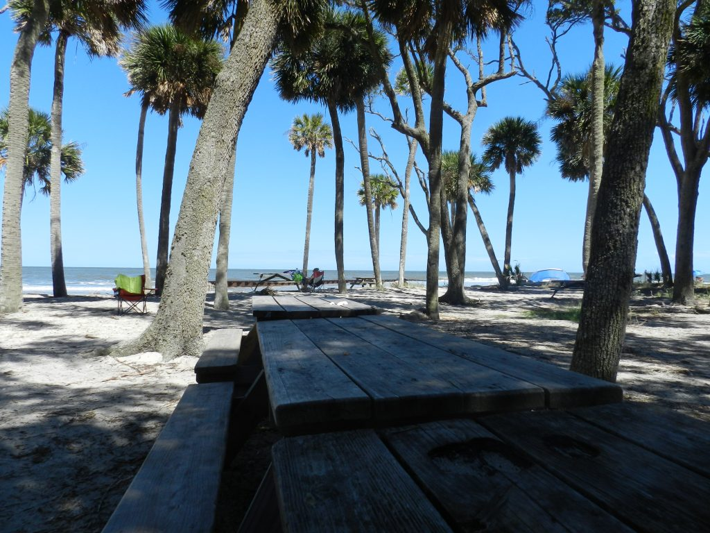 a picnic table with a view of the sea