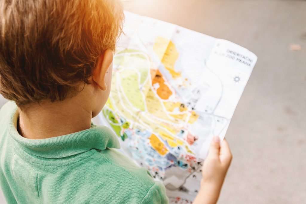 A child reading a map at homeschool