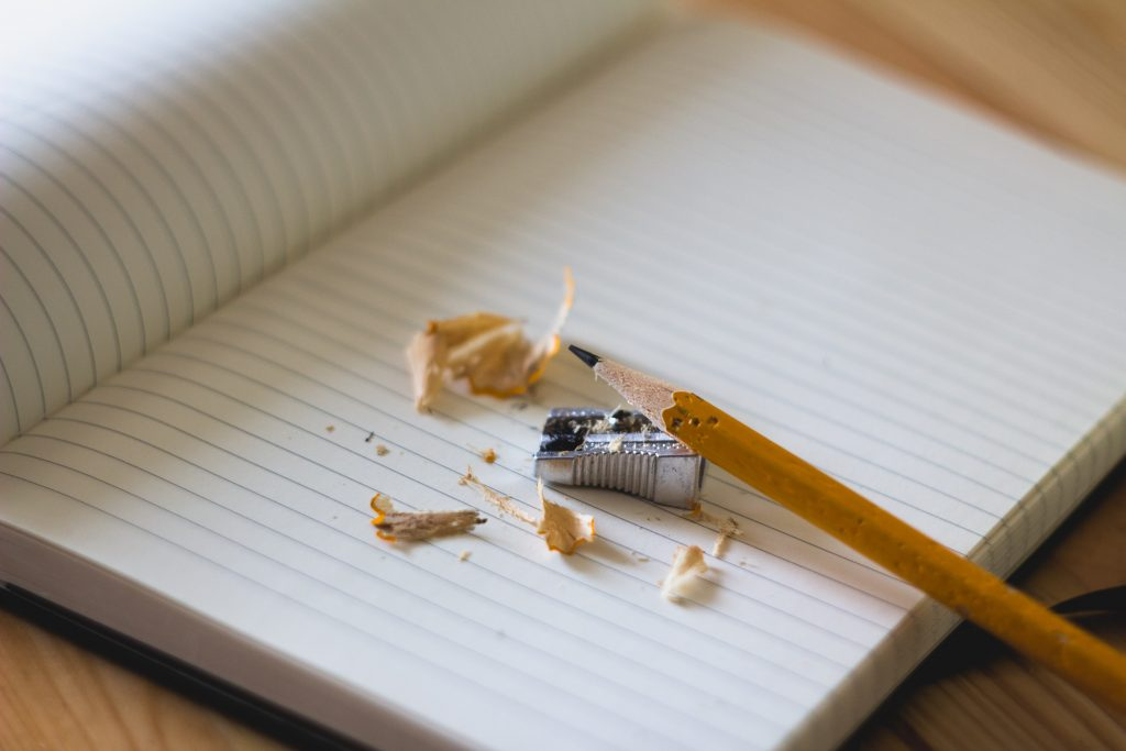 a pencil and a sharpener on a homeschooling textbook