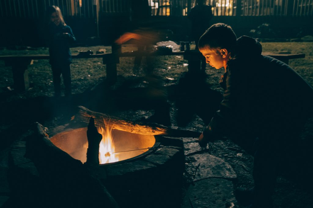survival based outdoor learning activity ideas for children, including lighting a campfire