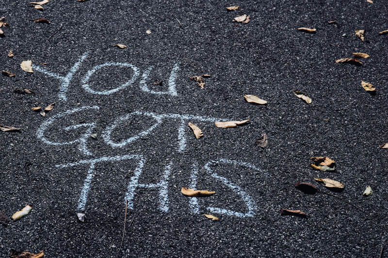 'you got this' written on the floor on chalk during a spelling lesson