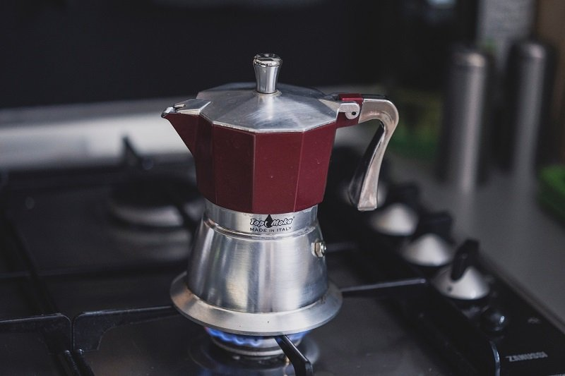 an italian coffee maker on the stove top in a sailboat home