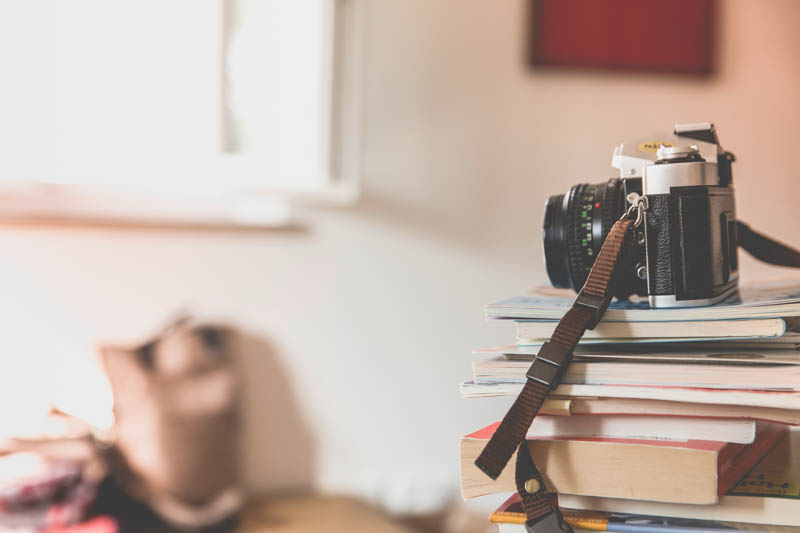 the best camera for blogging sat on a pile of books