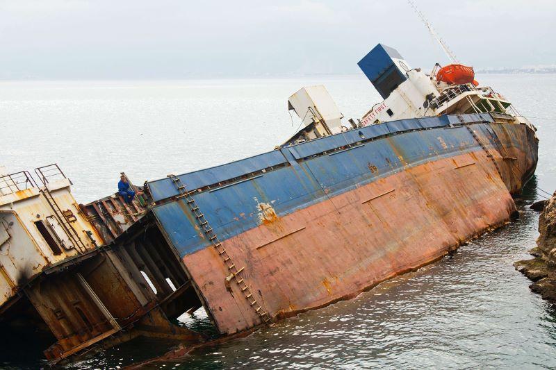 A sinking cargo boat on it's side