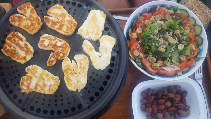 a cobb bbq cooking vegetarian food