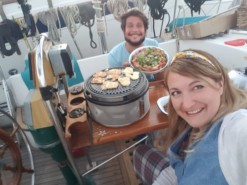 cheese cooking on a cobb bbq on a sailing boat
