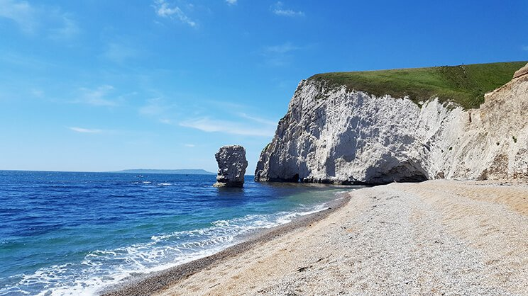 the end of durdle door beach where it's empty from the crowds