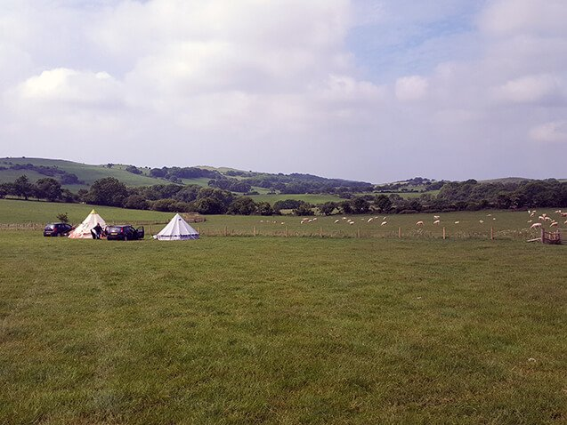 Lulworth cove campsite with a tipi and yurt tent
