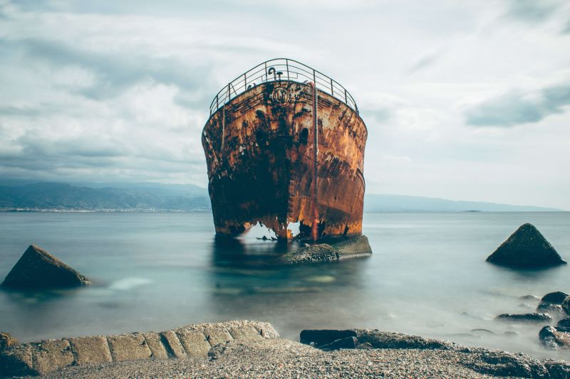 a rusty old sinking boat