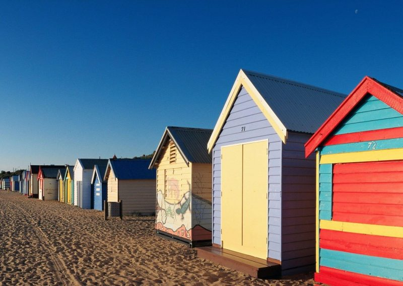 The colourful beach huts on a day trip to Brighton from London