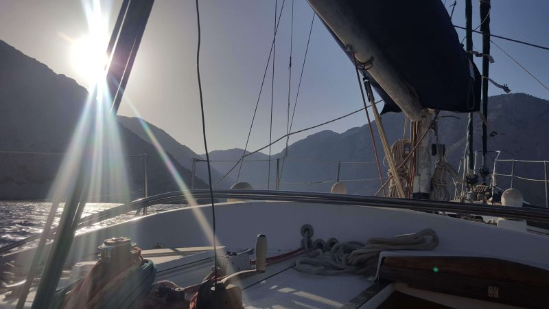 a sailboat sailing into the sun!
