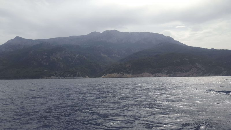 sailing towards kokkari in greece with amazing mountains in the background