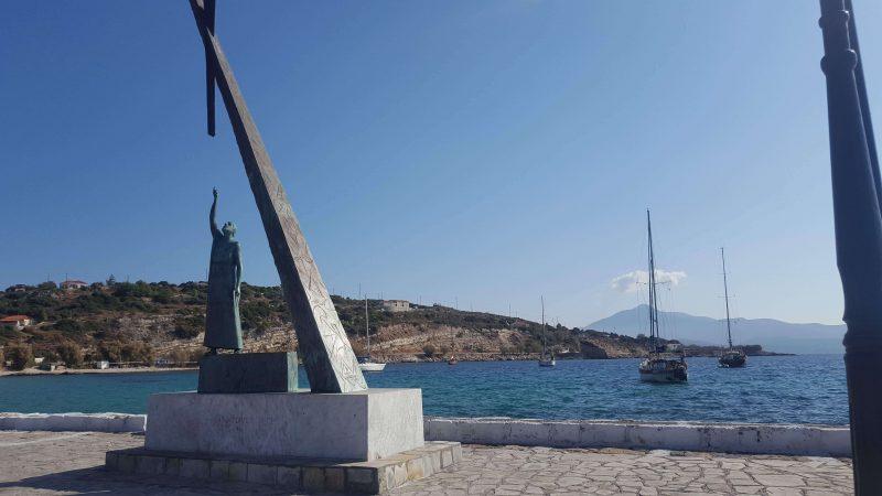 a sailboat in a greek bay