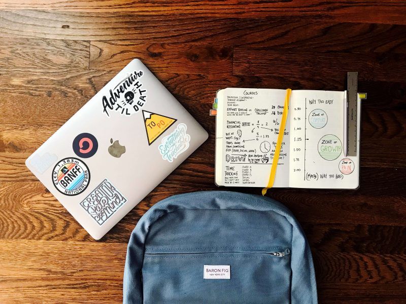 the best laptop for digital nomads on a table with a notebook and laptop