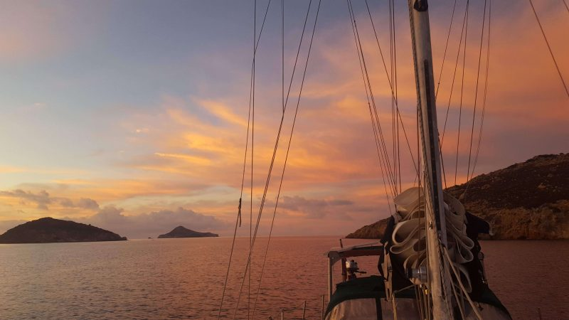 sailing greece in october at sunset