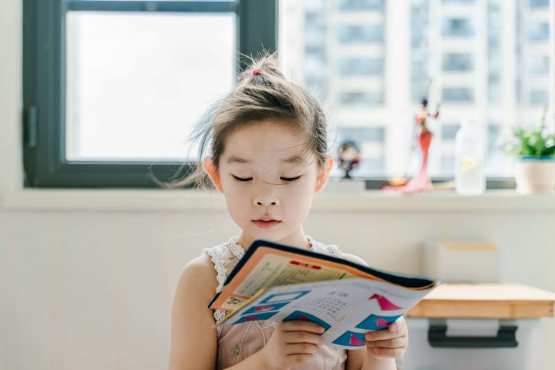 a girl finding ways to make homeschool fun by reading a book
