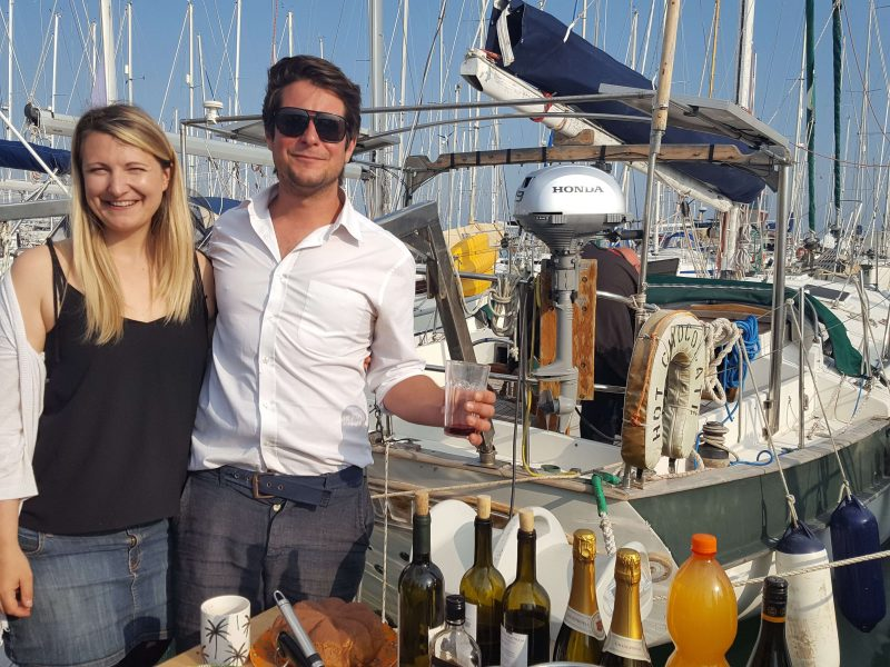 a couple sharing drinks with the community at marina di ragusa over winter